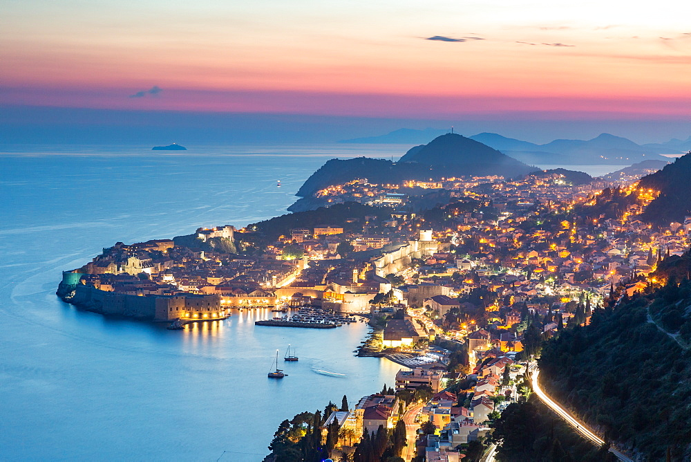 The city lights at sunset over the old town of Dubrovnik and the Dalmatian Coast, Croatia.