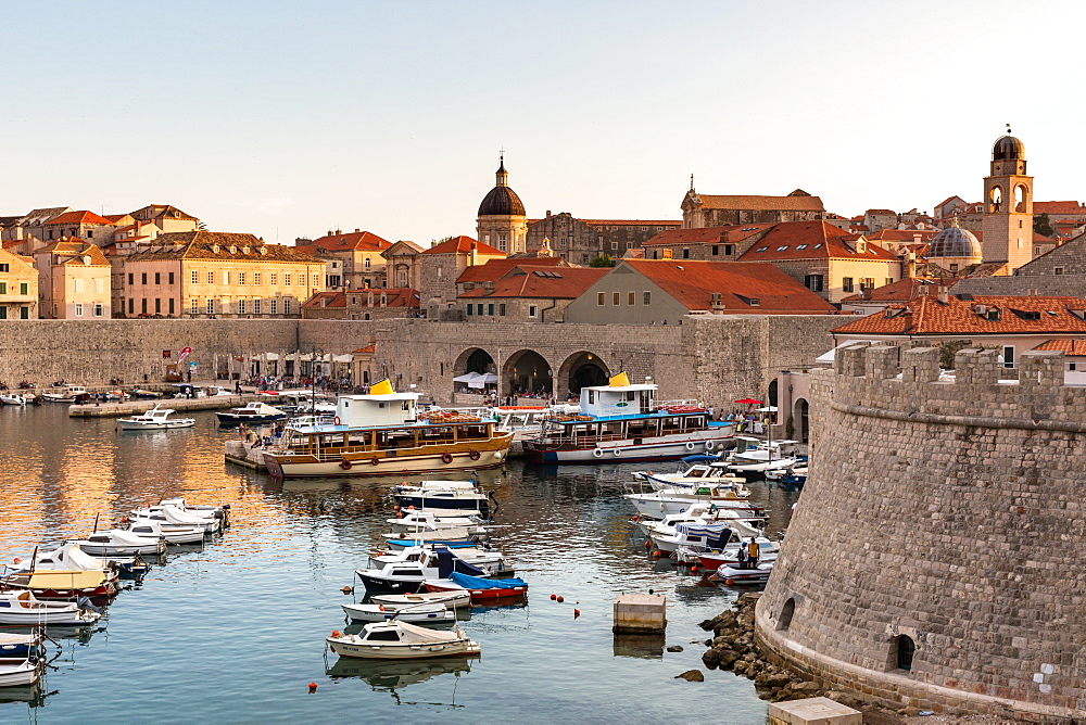 Boats in Dubrovnik harbour during sunset, UNESCO World Heritage Site, Dubrovnik, Croatia, Europe