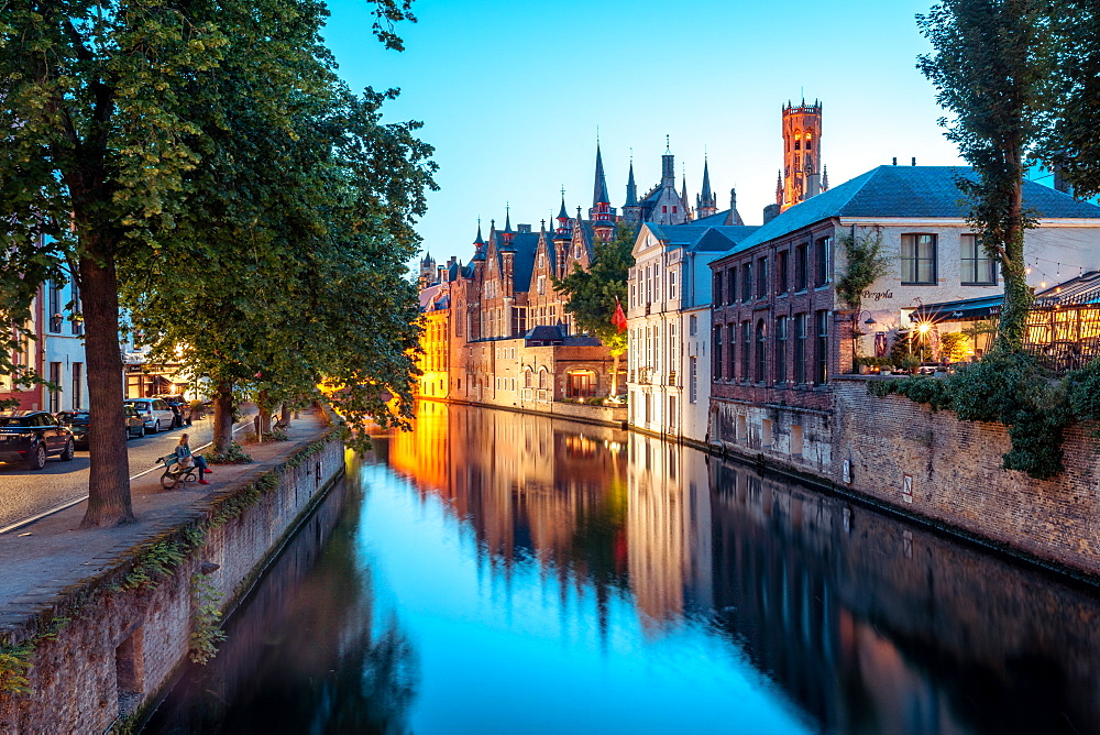 A tranquil canal scene in Bruges, with the spires of the Stadhuis (Town Hall) in the distance, Bruges, Belgium, Europe - 1263-156