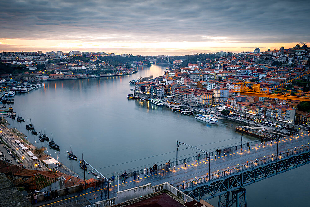 Sunset over Porto looking towards the Ribeira district and Dom Luis I Bridge over the River Douro, Porto, Portugal, Europe