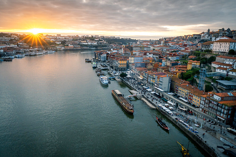Sunset over Porto looking towards the Ribeira district from the Dom Luis I Bridge, UNESCO World Heritage Site, Porto, Portugal, Europe