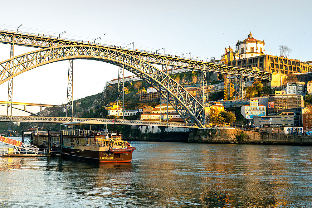 The Dom Luis I Bridge at sunset looking towards the Monastery of Serra do Pilar, UNESCO World Heritage Site, Porto, Portugal, Europe