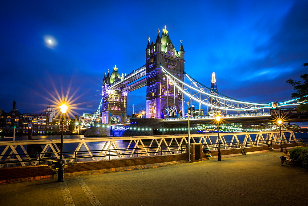 A moonlit evening in London with a view of the Tower Bridge and Shard.