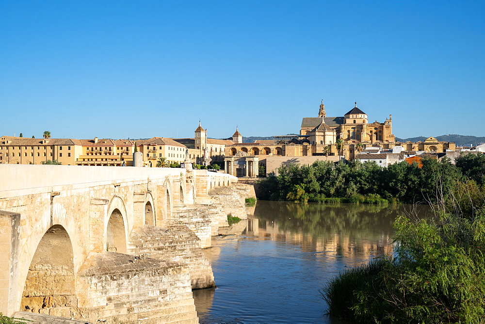 The Roman Bridge (Puente Romano) and The Great Mosque of Cordoba on a sunny day. Andalusia. Spain