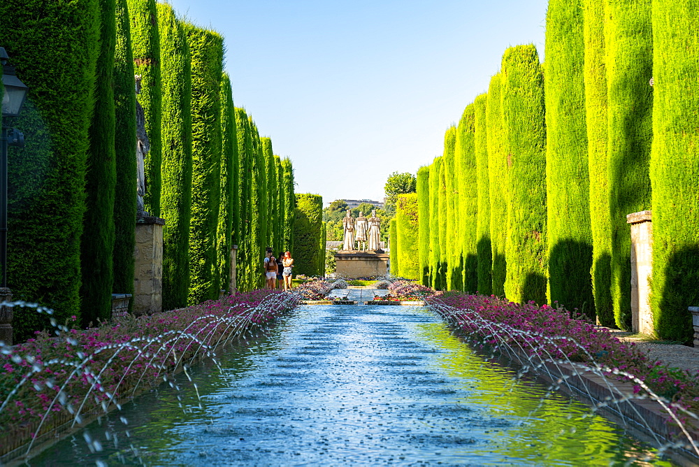 Cypress trees, statues and fountains in the gardens of the Alcazar de Los Reyes Cristianos, UNESCO World Heritage Site, Cordoba, Andalusia, Spain, Europe