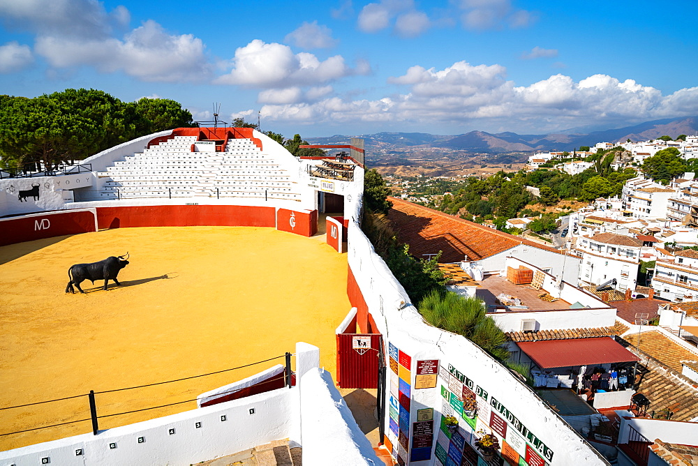 A view over Mijas bullring, Plaza de Toros, and the whitewashed buildings of the Andalusia town of Mijas Pueblo, Andalusia, Spain, Europe