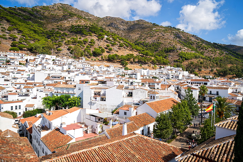 Mountains provide the backdrop to the white washed buildings of Mijas Pueblo, Andalusia, Spain.