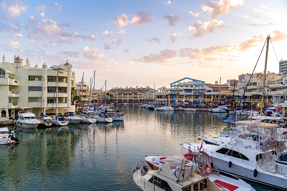 Benalmadena's Puerto Marina at sunset sitting between the Costa Del Sol beach resorts of Benalmadena and Torremolinos, Andalusia, Spain, Europe