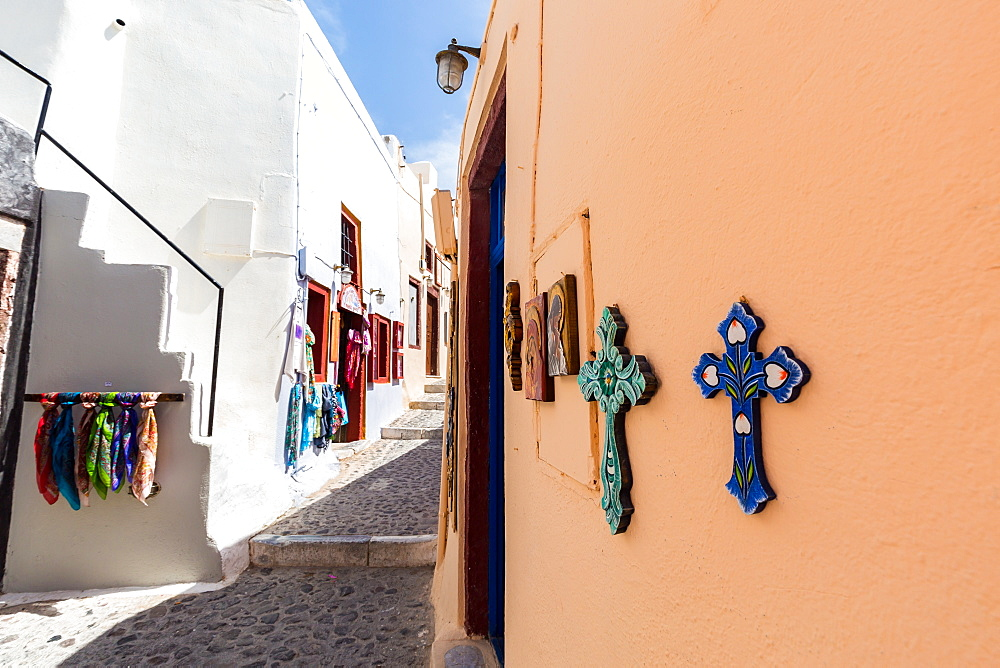 Souvenir crosses on the outside of a shop on a street in Oia, Santorini, Cyclades, Greek Islands, Greece, Europe - 1263-33
