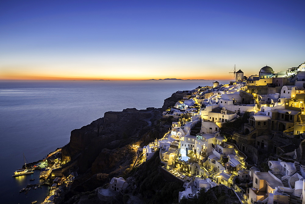 Long exposure sunset view over the whitewashed buildings and windmills of Oia, Santorini, Cyclades, Greek Islands, Greece, Europe - 1263-41