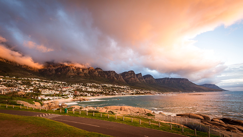 Sunset and clouds over Camps Bay, Table Mountain and the Twelve Apostles, Cape Town, South Africa, Africa