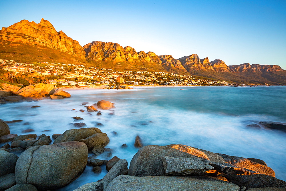 Long exposure at sunset in Camps Bay with Table Mountain and its cable car on the left and the Twelve Apostles to the right, Western Cape, South Africa, Africa - 1263-59