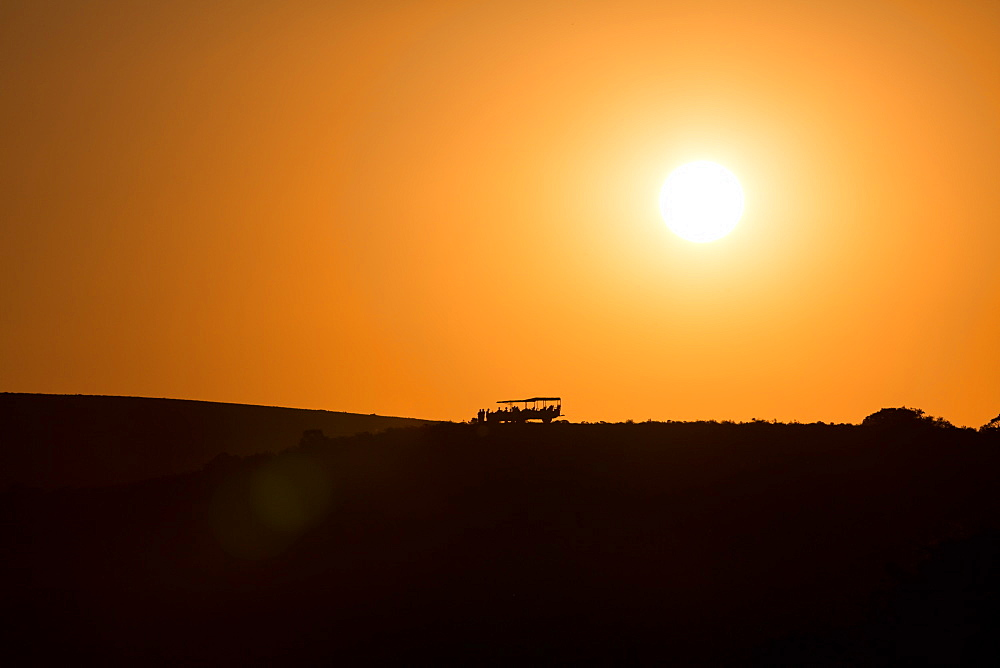 Sundowners at sunset over a South African Game Reserve, Eastern Cape, South Africa, Africa