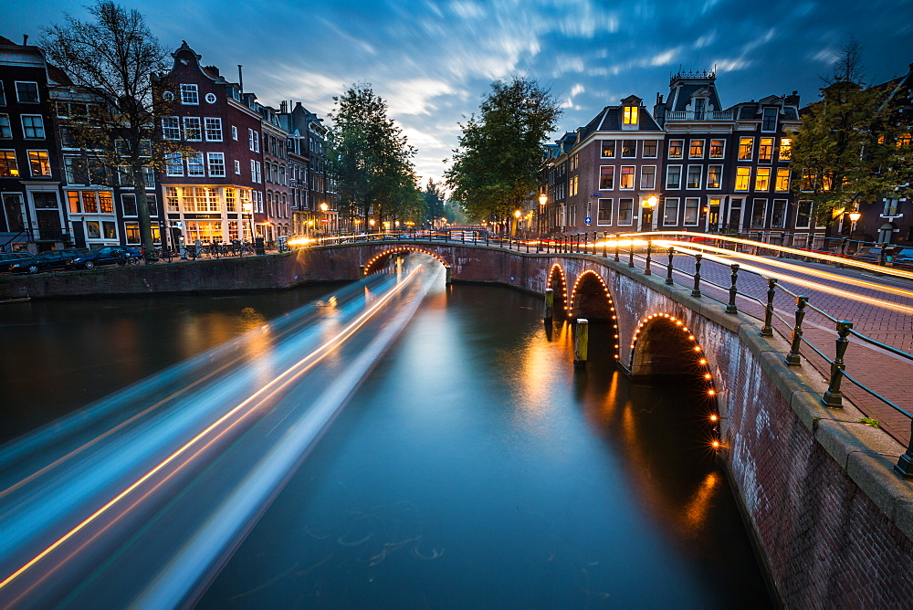 A long exposure of Amsterdam's southern canal rings at the intersection of Leidsegracht and Keizersgracht, Amsterdam, The Netherlands, Europe