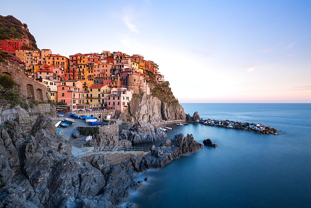 Beautiful sunset light shines on the colourful town of Manarola during a long exposure, Manarola, Cinque Terre, UNESCO World Heritage Site, Liguria, Italy, Europe - 1263-88