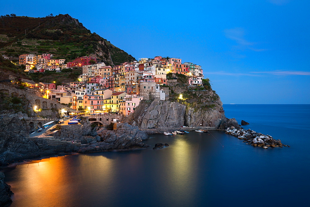A long exposure at blue hour as the lights come on in the colourful town of Manarola, Cinque Terre, UNESCO World Heritage Site, Liguria, Italy, Europe - 1263-89