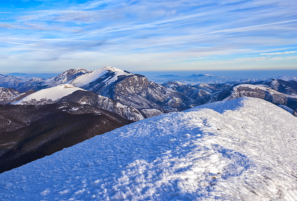 Sunrise on Mountain Catria from the summit of Cucco in winter, Apennines, Umbria, Italy, Europe - 1264-105