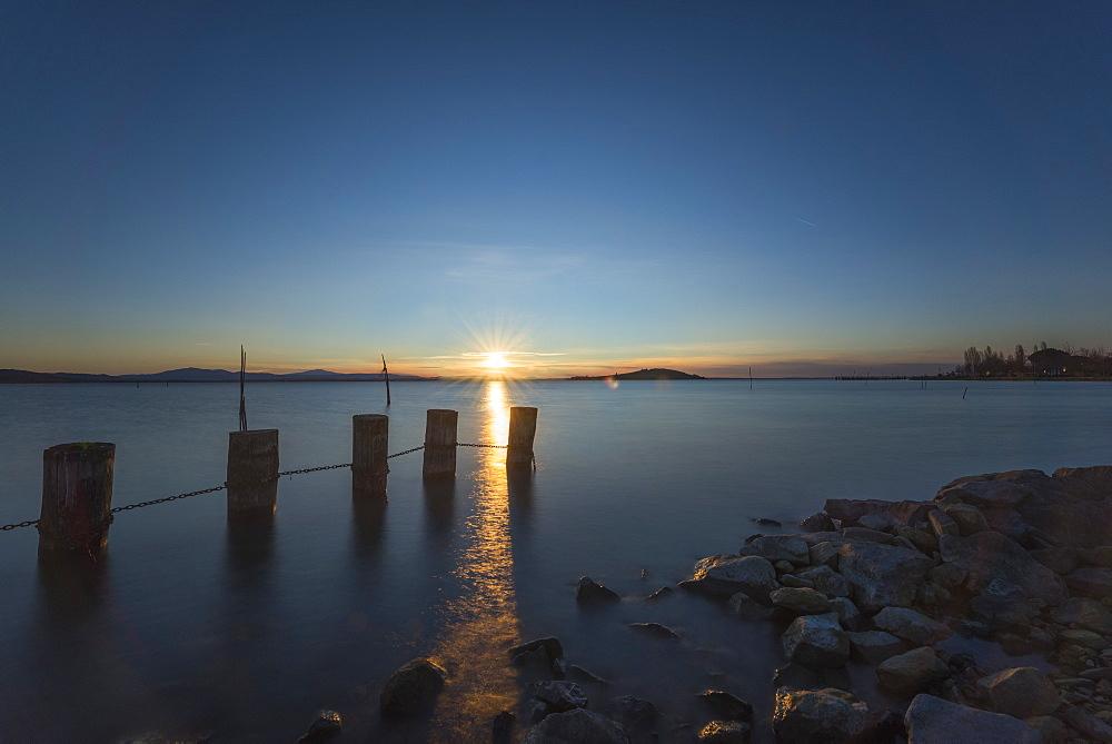 Wooden dock at sunset, Lake Trasimeno, Perugia, Umbria, Italy, Europe