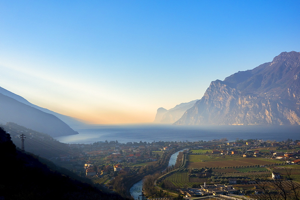 Italy, Dolomites, Trentino, Lake Garda, Riva del Garda at sunrise in Winter