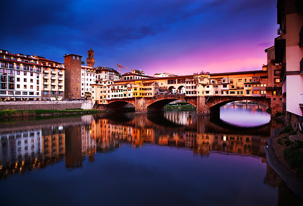 Ponte Vecchio at sunset reflecting in River Arno, Florence, UNESCO World Heritage Site, Tuscany, Italy, Europe