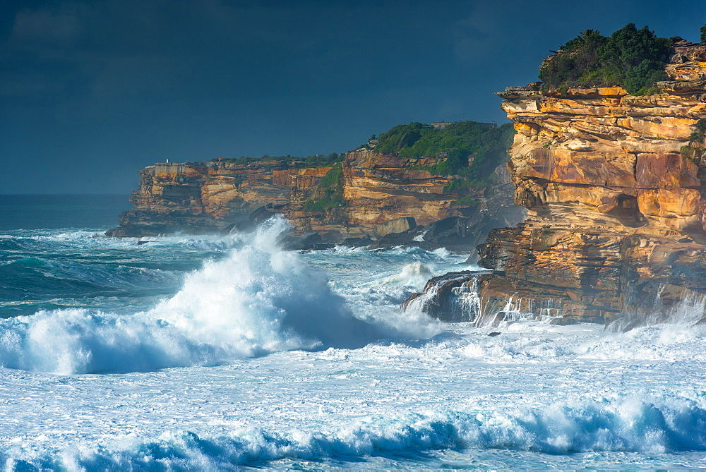 Stormy sea and sky off the coastal walk between Bondi and Tamarama beaches, Sydney, New South Wales, Australia, Pacific