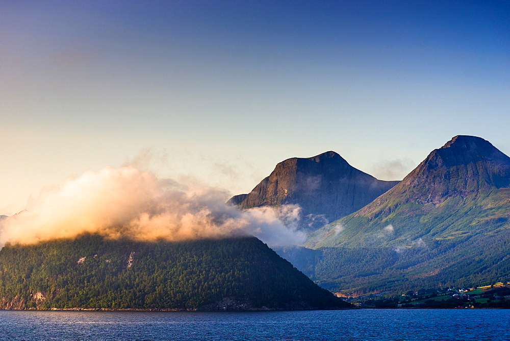 Low cloud catches the setting sun on Nordfjord or Northern Fjord, Norway.