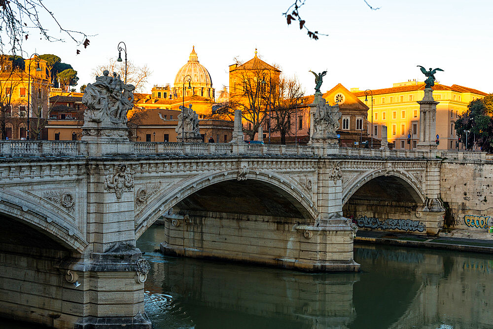 Sunrise hits the Vatican and St. Peter's Basilica but has not reached Vittorio Emanuele II bridge in the foreground, Rome, Lazio, Italy, Europe - 1267-257