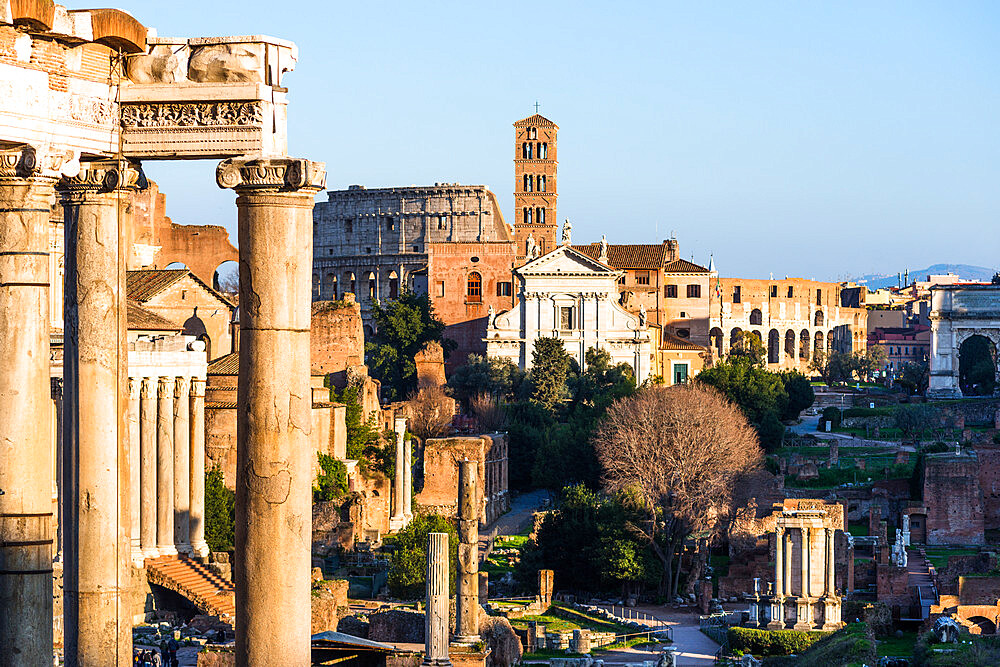 Ancient Roman cityscape at Roman Forum with Basilica of Maxentius and the Coliseum. Rome, Italy.