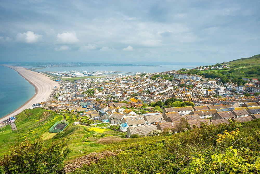 Fortuneswell and the Chesil Beach, seen from Portland Heights on the Isle of Portland, Dorset, England, UK.