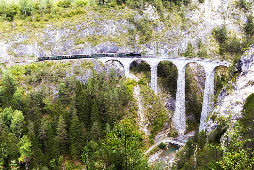 Steam train transits on Landwasser Viadukt, Filisur, Albula Valley, Graubünden, Switzerland, Europe. - 1269-107