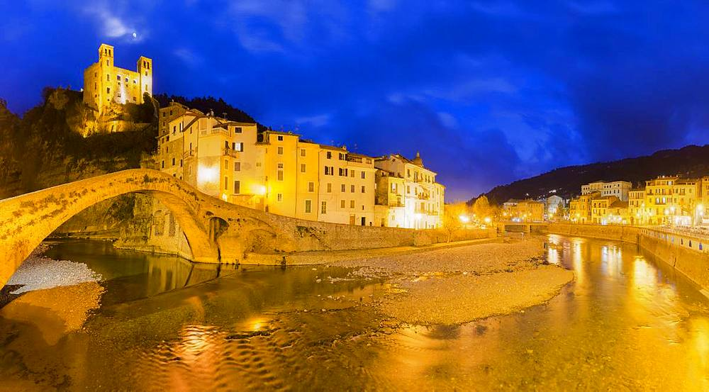 The lights are reflected in the river during twilight. Dolceacqua, Province of Imperia, Liguria, Italy, Europe. - 1269-132