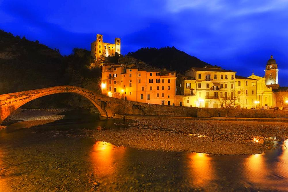 The lights are reflected in the river during twilight. Dolceacqua, Province of Imperia, Liguria, Italy, Europe. - 1269-133