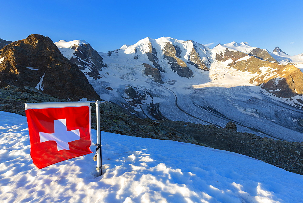 Swiss flag with Palu and Vedret Pers Glacier, Diavolezza Refuge, Bernina Pass, Engadine, Graubunden, Switzerland, Europe