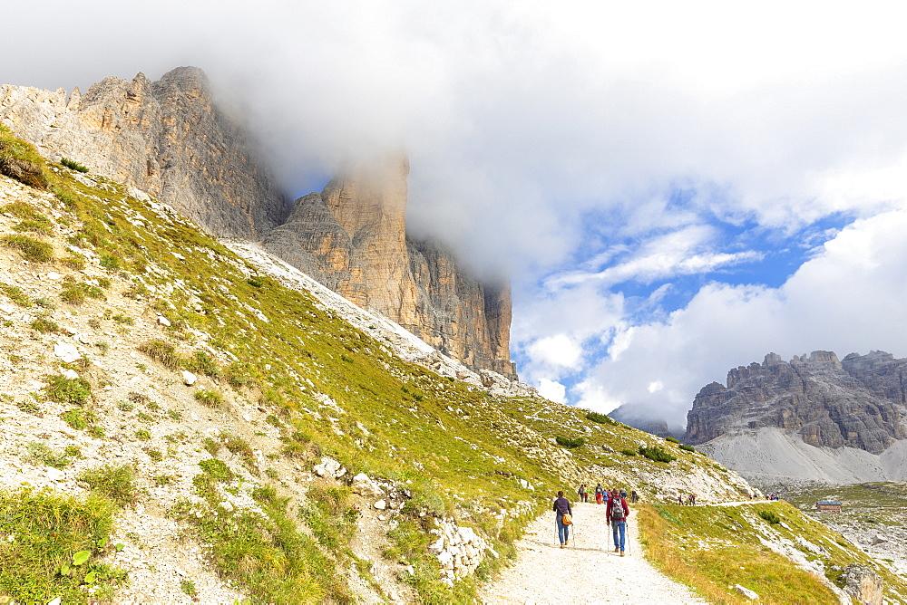 Tourists walks on the pathway for Three Peaks of Lavaredo, Dolomites of Sesto, Province of Belluno, Veneto, Italy, Europe