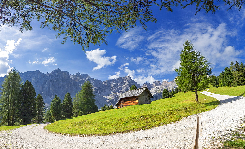 White track with traditional hut and Puez Group in the background, Longiaru, Badia Valley, South Tyrol, Dolomites, Italy, Europe