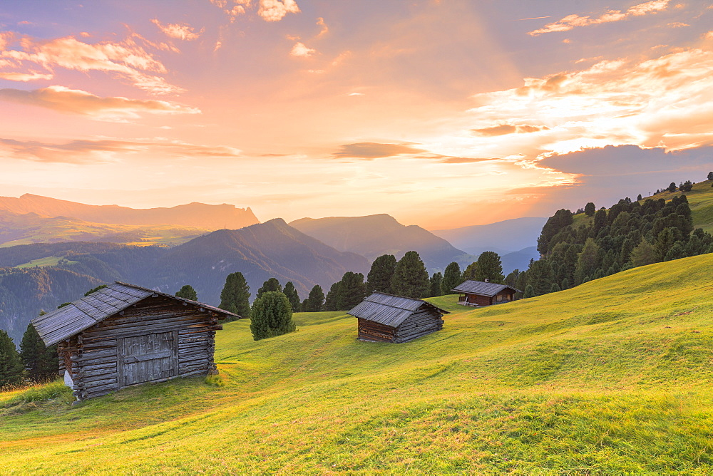 Sunset above traditional huts in the pasture, Gardena Valley, South Tyrol, Dolomites, Italy, Europe - 1269-296