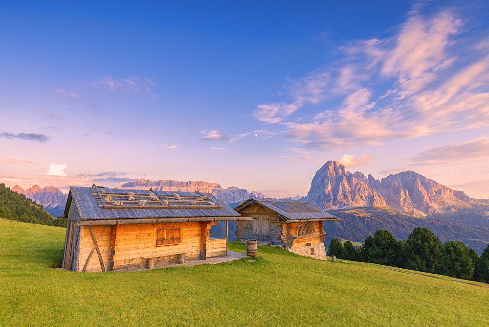 Traditional huts at sunset with Sassolungo and Sella Group in the background, Gardena Valley, South Tyrol, Dolomites, Italy, Europe - 1269-301