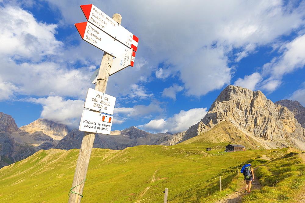 Hiking signs at San Nicolo Pass, Fassa Valley, Trentino, Dolomites, Italy, Europe