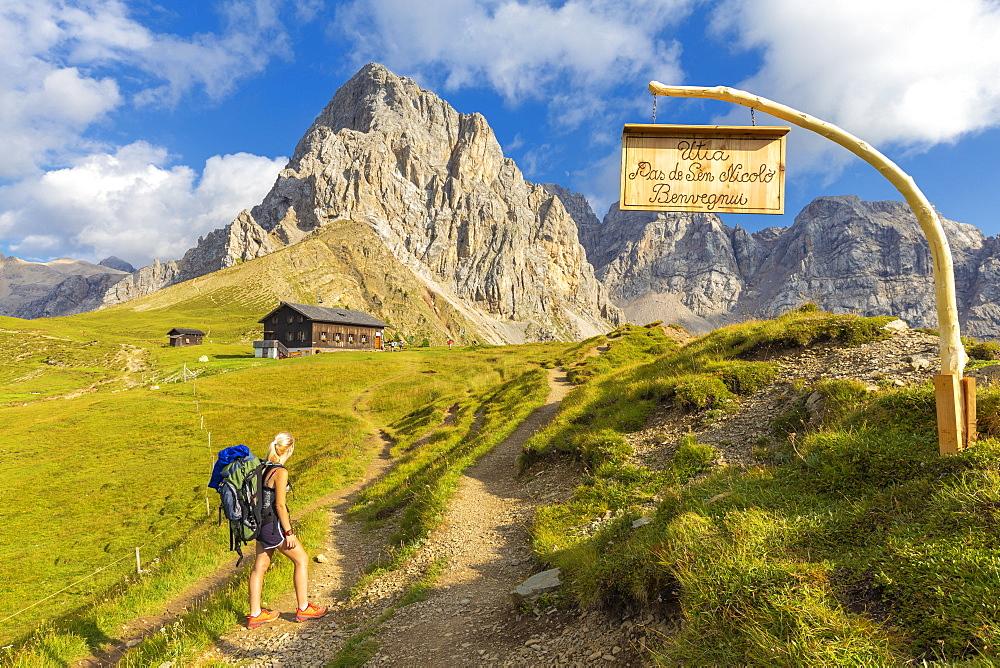 Hiker at Passo San Nicolò Refuge. San Nicolò Pass, Fassa Valley, Trentino, Dolomites, Italy, Europe. - 1269-319