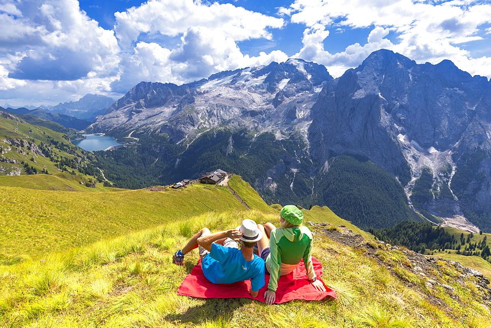 Tourists looks Viel del Pan Refuge with Marmolada in the background. Pordoi Pass, Fassa Valley, Trentino, Dolomites, Italy, Europe. - 1269-327