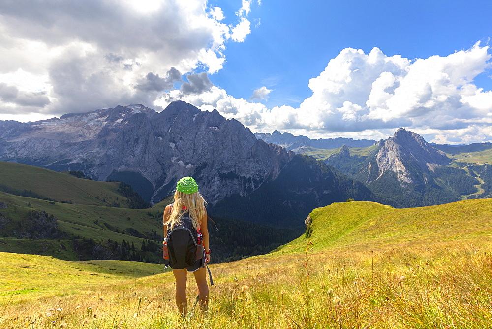 Girl looks Marmolada from Viel del Pan path. Pordoi Pass, Fassa Valley, Trentino, Dolomites, Italy, Europe. - 1269-332