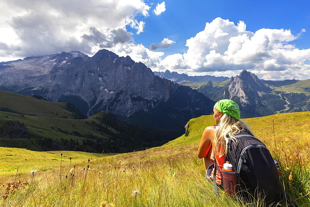 Girl looks towards Marmolada from Viel del Pan path, Pordoi Pass, Fassa Valley, Trentino, Dolomites, Italy, Europe