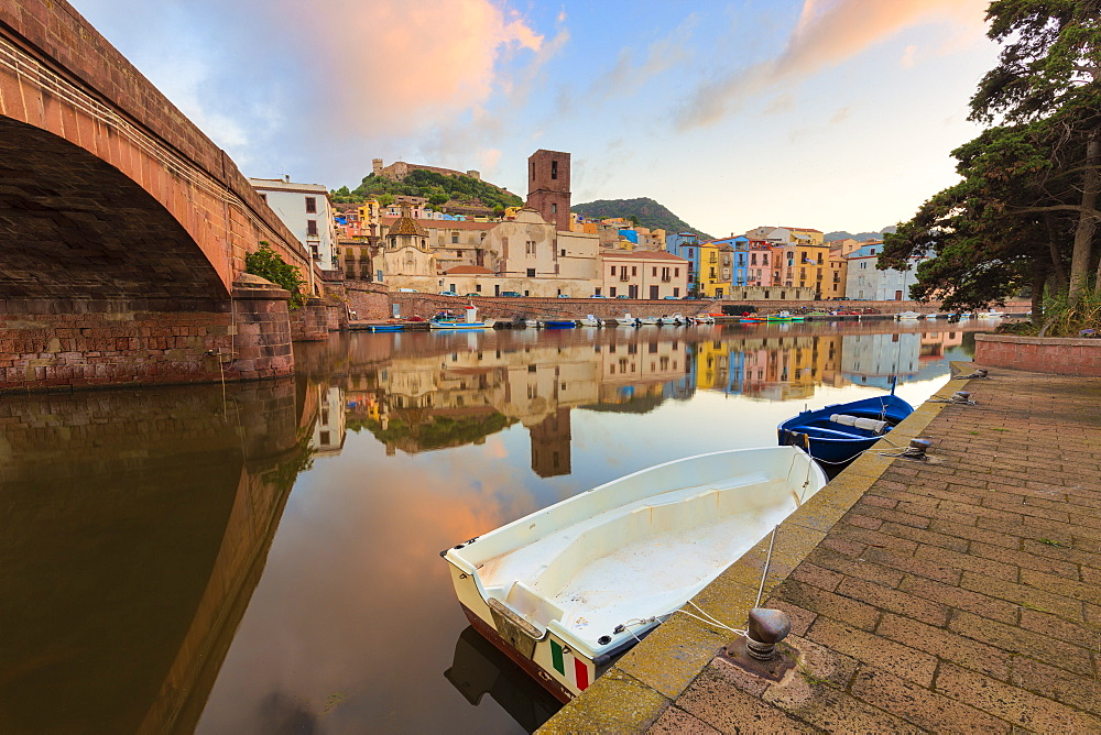 Moored boats in the river during sunrise. Bosa, Oristano province, Sardinia, Italy, Europe.