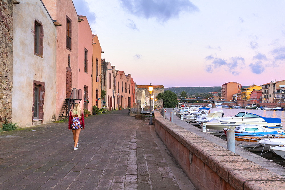 A girl walks at sunrise, Bosa, Oristano province, Sardinia, Italy, Mediterranean, Europe