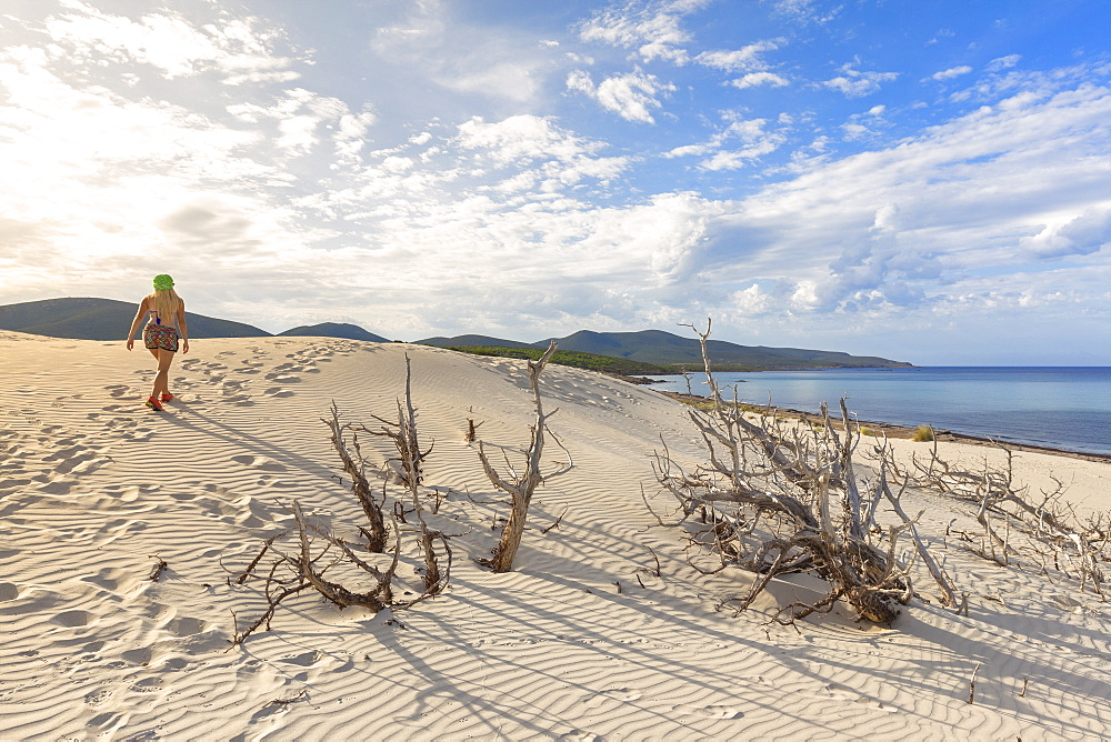 A girl walks on the sand dune of Is Arenas Biancas, Teulada, Cagliari province, Sardinia, Italy, Mediterranean, Europe - 1269-387