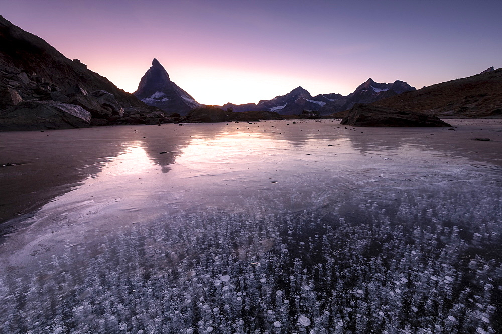 Ice bubbles in the Riffelsee Lake during sunset. Zermatt, Mattertal, Canton of Valais, Switzerland, Europe - 1269-394