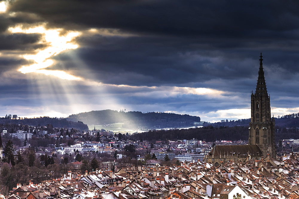 Sun ray between clouds above Bern Minster (Cathedral) (Berner Munster), Bern, Canton of Bern, Switzerland, Europe