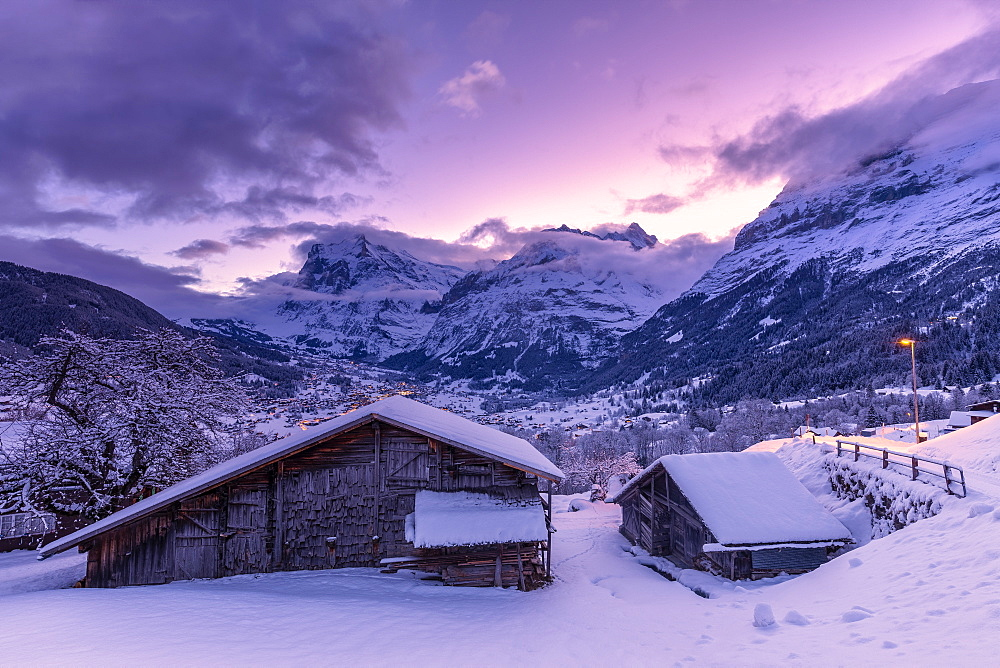 Traditional hut at sunrise after a snowfall, Grindelwald, Canton of Bern, Switzerland, Europe