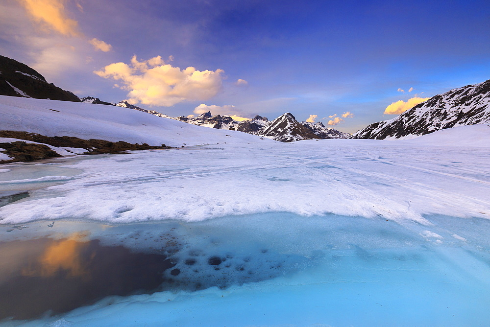 Sunset during thaw at the Malghera Lake. Valtellina, Lombardy, Italy, Europe. - 1269-446