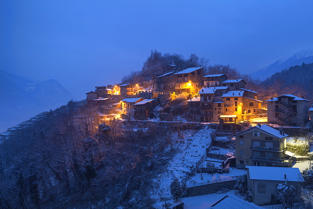 Twilight at the small village of Maroggia. Berbenno di Valtellina, Valtellina, Lombardy, Italy, Europe.